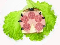 Panino di verdure creativo con formaggio ed il prosciutto Fotografia Stock