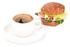 Panino e caffè di prosciutto fotografie stock