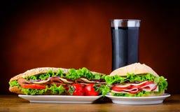 Panino ed hamburger con cola fredda Fotografia Stock Libera da Diritti