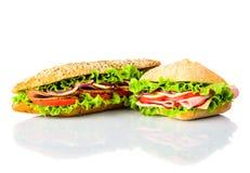 Panino ed hamburger isolati su fondo bianco Immagini Stock Libere da Diritti