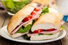 Panino italiano di panini con il prosciutto, il formaggio ed il pomodoro Fotografia Stock Libera da Diritti