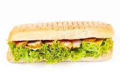 Panino lungo con carne, i pomodori e la lattuga Immagine Stock
