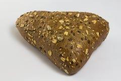 panino nella forma di triangolo spruzzata con i semi di girasole Fotografie Stock Libere da Diritti