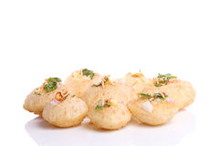 Panipuri stuffed with tasty masala. Number of panipuri are stuffed with tasty masala and placed near to each other  and isolated against white background Stock Photo