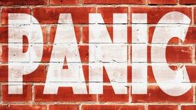 Panique sur un mur de briques Photos libres de droits