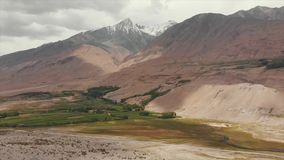 Panj River and Pamir Mountains, Panj Is Upper Part of Amu Darya River. Panoramic View, Tajikistan and Afghanistan Border. Areal Dron Shoot View of the Pamir stock video footage