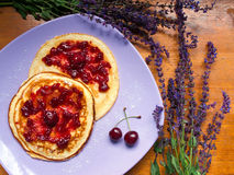 Pankakes with cherries Stock Photos