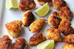 Panko fried lobster tail nuggets with lime upclose Royalty Free Stock Image