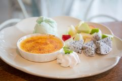 Creme Brulee with Ice Cream, Dessert. Creme Brulee with Ice Cream on a plate stock image