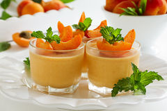 Panna cotta with apricots Royalty Free Stock Photos
