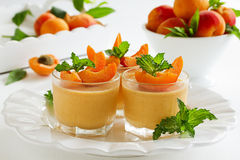 Panna cotta with apricots. Summer dessert panna cotta with apricots royalty free stock photography