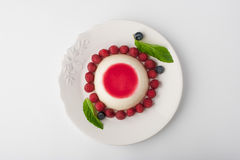 Panna cotta with berries and mint  top view Stock Photos