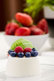 Panna cotta with Berries on white table Royalty Free Stock Image