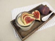 Panna cotta with cinnamon in jar and figs garnish Stock Photo
