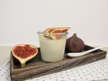 Panna cotta with cinnamon in jar and figs garnish Stock Image
