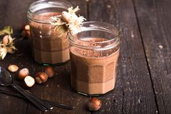 Panna cotta classic italian dessert sprinkled with cocoa powder decorated with cinnamon stick stock image