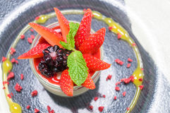 Panna Cotta Decorated with Strawberry and Mint. Royalty Free Stock Image