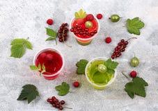 Panna cotta dessert cream currants gooseberries raspberries Stock Photo