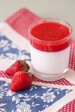 Panna cotta dessert with strawberry sirup Royalty Free Stock Image