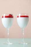 Panna cotta dessert with strawberry sirup Stock Photography