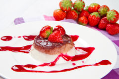 Panna cotta dessert with strawberry. Sirup and fresh strawberry Royalty Free Stock Photography