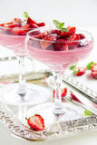 Panna cotta dessert with strawberry sirup Stock Photos