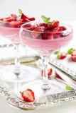 Panna cotta dessert with strawberry sirup Stock Photos
