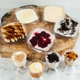 Panna cotta - desserts of different flavors and presentation.  royalty free stock photos