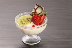 Panna cotta with fruit stock photography