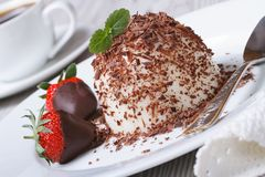Panna cotta with grated dark chocolate and strawberries stock photos