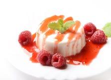 Panna cotta. Italian dessert panna cotta with raspberries Royalty Free Stock Image