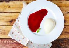 Panna cotta Italian dessert with raspberry sirup Stock Photo