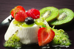 Panna cotta with kiwi cream and berries Royalty Free Stock Photography