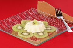 Panna cotta with kiwi slices Royalty Free Stock Images
