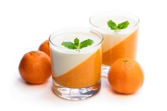 Panna cotta with orange jelly in clear glass isolated on white. Panna  cotta with orange jelly in clear glass isolated on white stock photography