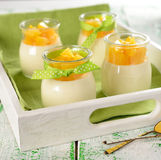 Panna cotta in small jars Stock Images