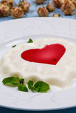 Panna cotta with strawberry jam Stock Photo