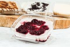 Panna cotta - tasty dessert with blackberry sauce stock photography