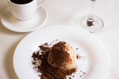 Panna cotta topped with grated chocolate on a white plate Royalty Free Stock Photo