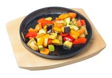 Panna med sauteed grönsaker Arkivbild