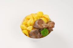 Panna stekt potatisar och feg lever arkivbild