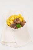 Panna stekt potatisar och feg lever arkivfoton