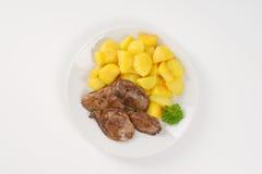 Panna stekt potatisar och feg lever royaltyfri foto