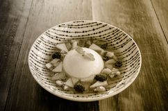 Pannacotta with fresh fruits in white plate. Royalty Free Stock Images