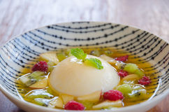 Pannacotta with fresh fruits in white plate. Stock Photos