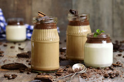 Pannacotta in a jar in two variations. Royalty Free Stock Images