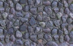 Panne ilumina - pedras escuras cinzentas a parede empilhada do fundo textured resistido fonte secado velho do close up imagens de stock