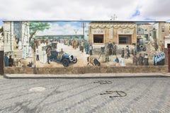 Panneau artistique dépeignant des scènes de la visite de la ville d'Evpa photos stock