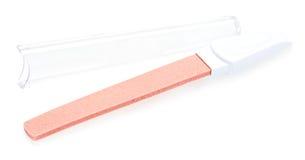 Panneau d'émeri en plastique rouge de clou Photo libre de droits