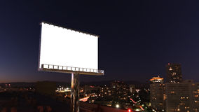 Panneau d'affichage dans la ville de nuit Photographie stock